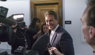 Sen. Jeff Flake, R-Ariz., is questioned by reporters about changing his vote to yes on President Trump's nomination of Oklahoma congressman James Bridenstine to run NASA, on Capitol Hill in Washington, Thursday, April 19, 2018. (AP Photo/J. Scott Applewhite)