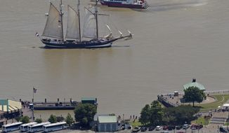The Oosterschelde, a three-masted schooner from the Netherlands, makes its way up the Mississippi River past the French Quarter in New Orleans, La., Thursday, April 19, 2018. The ship is one of four tall ships which will dock in New Orleans as part of the  300th anniversary celebration of the city in tandem with Nola Navy Week. Visitors will be able to tour the ships this weekend.  (Max Becherer/The Advocate via AP)