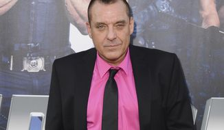 "FILE - In this Aug. 11, 2014 file photo, actor Tom Sizemore arrives at the premiere of ""The Expendables 3"" in Los Angeles. A stuntman who was pinned beneath an SUV driven by Tom Sizemore on a TV production has settled a lawsuit with the actor and Paramount Pictures. Court papers show a notice of settlement was filed March 29. No terms were disclosed. (Photo by Jordan Strauss/Invision/AP, File)"