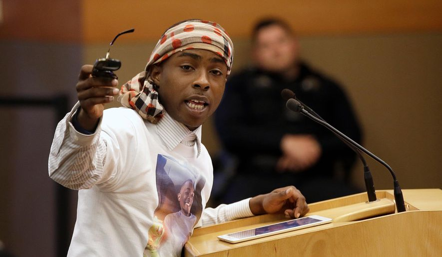 FILE--In this April 10, 2018, file photo, Stevante Clark, the brother of Stephon Clark, who was shot and killed by Sacramento police, speaks before a meeting of the Sacramento City Council in Sacramento, Calif. Clark was arrested on Thursday, April 19, 2018, and accused of making threats to commit a crime resulting in death or great bodily injury and telephoning 911 with the intent to annoy or harass. (AP Photo/Rich Pedroncelli, file)