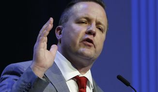Republican primary senatorial candidate Corey Stewart gestures during a debate with E. W. Jackson and Del. Nick Freitas at Liberty University in Lynchburg, Va., Thursday, April 19, 2018. (AP Photo/Steve Helber)