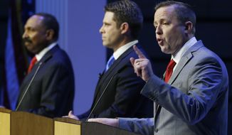 CORRECTS JACKSON'S FIRST NAME TO E.W., NOT L.W. - Republican senatorial candidate, Corey Stewart, left, gestures during a debate between Republican primary senatorial candidates E.W. Jackson, left, Del. Nick Freitas, center, at Liberty University in Lynchburg, Va., Thursday, April 19, 2018. (AP Photo/Steve Helber)