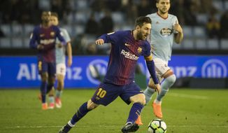 Barcelona's Lionel Messi, in action, during a Spanish La Liga soccer match between RC Celta and Barcelona at the Balaidos stadium in Vigo, Spain, Tuesday April 17, 2018. (AP Photo/Lalo R. Villar)