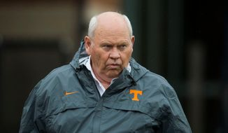 FILE - In this March 20, 2018, file photo, Tennessee's athletic director Phillip Fulmer watches during the first day of spring NCAA college football practice, in Knoxville, Tenn. Fulmer has signed a contract that runs through 2021 and increases his annual pay to at least $900,000. The deal was announced Thursday, April 19, 2018, by Tennessee chancellor Beverly Davenport in a university release. (Caitie McMekin/Knoxville News Sentinel via AP, File)