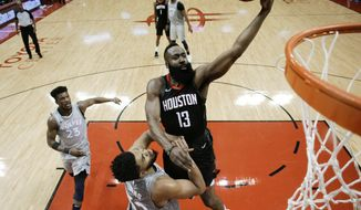 Houston Rockets guard James Harden (13) drives to the basket over Minnesota Timberwolves center Karl-Anthony Towns during the first half in Game 2 of a first-round NBA basketball playoff series Wednesday, April 18, 2018, in Houston. (AP Photo/Eric Christian Smith)