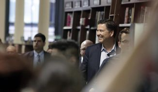 Former FBI director James Comey arrives at a Barnes & Noble book store to speak to an audience Wednesday, April 18, 2018, in New York. (AP Photo/Frank Franklin II)