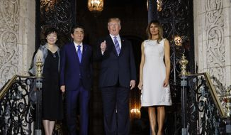 President Donald Trump and first lady Melania Trump host Japanese Prime Minister Shinzo Abe and his wife Akie Abe, for dinner at Trump's private Mar-a-Lago club, Wednesday, April 18, 2018, in Palm Beach, Fla. (AP Photo/Pablo Martinez Monsivais)