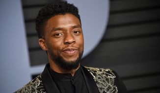 FILE - In this March 4, 2018, file photo, Chadwick Boseman arrives at the Vanity Fair Oscar Party in Beverly Hills, Calif. Howard University said in a statement Wednesday, April 18, that Boseman will give the keynote address at his alma mater's commencement ceremony on May 12. (Photo by Evan Agostini/Invision/AP, File)