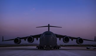 In this image provided by the U.S. Air Force, a C-17 Globemaster III, assigned to the 816th Expeditionary Airlift Squadron, conducts combat airlift operations for U.S. and coalition forces in Iraq and Syria on April 13, 2018. The drama of U.S. and allied missiles strikes on Syria has obscured the fact that the U.S.-led campaign to eliminate the Islamic State from Syria has stalled. This is an illustration of the many-layered complexities of the Syrian conflict.  (U.S. Air Force Photo by Tech. Sgt Gregory Brook)