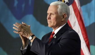 Vice President Mike Pence applauds to the crowd after speaking at an event on tax policy in Charlotte, N.C., Friday, April 20, 2018. (AP Photo/Chuck Burton) ** FILE **