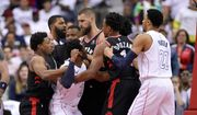 Washington Wizards guard John Wall (2) and forward Otto Porter Jr. (22) scuffle with Toronto Raptors guard DeMar DeRozan (10) and center Jonas Valanciunas, third from right, guard Kyle Lowry, far left, and others during the first half of Game 3 of an NBA basketball first-round playoff series, Friday, April 20, 2018, in Washington. (AP Photo/Nick Wass)