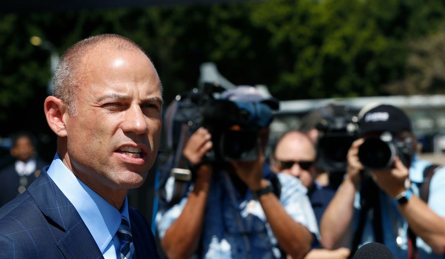 Stormy Daniels' attorney, Michael Avenatti talks to the media outside federal court in Los Angeles Friday, April 20, 2018. (AP Photo/Damian Dovarganes)