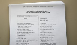 A lawsuit that was filed by the Democratic National Committee is photographed Friday, April 20, 2018, in Washington. The national Democratic Party sued President Donald Trump's campaign, his son, his son-in-law, the Russian Federation and WikiLeaks on Friday, accusing them of an intricate conspiracy to undercut Democrats in the 2016 election by stealing tens of thousands of emails and documents. (AP Photo/Alex Brandon)