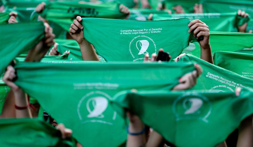 Green handkerchiefs have become a near-ubiquitous symbol for the cause of legalized abortion in Argentina. (Associated Press/File)