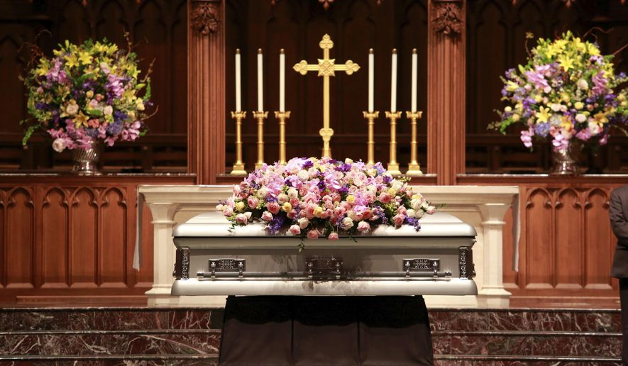 Former U.S. first lady Barbara Bush lies in repose at St. Martin's Episcopal Church Friday, April 20, 2018, in Houston, prior to the public visitation. (Richard Carson/Pool via AP)