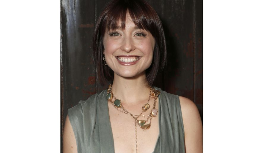 "FILE - This June 26, 2012, file photo shows television actress Allison Mack at a party in Los Angeles. Federal prosecutors say television actress Allison Mack, from ""Smallville"" has been charged with sex trafficking for helping recruit women to be slaves of a man who sold himself as a self-improvement guru. Mack, 35, was accused in an indictment unsealed Friday in federal court in Brooklyn. She was scheduled to appear in court later Friday. (Photo by Todd Williamson/Invision/AP, File)"