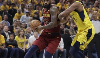 Cleveland Cavaliers' LeBron James (23) goes to the basket as Indiana Pacers' Myles Turner defends during the first half of Game 3 of a first-round NBA basketball playoff series Friday, April 20, 2018, in Indianapolis. (AP Photo/Darron Cummings)