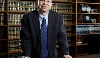 FILE - in this June 27, 2011, file photo, Santa Clara County Superior Court Judge Aaron Persky poses in Santa Clara, Calif. Persky, who faces a recall vote over his handling of a sexual assault case involving a Stanford University swimmer, said in an interview Thursday, April 19, 2018, that says he supports the movement to improve how sexual assault victims are treated, but added that ousting him will not help the cause. (Jason Doiy/The Recorder via AP, File)