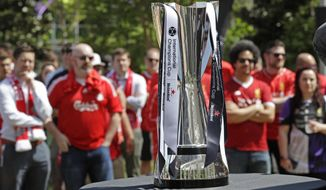 The International Champions Cup is shown as Liverpool soccer fans listen during a news conference in Charlotte, N.C., Thursday, April 19, 2018. Liverpool F.C. will play Borussia Dortmund on July 22, 2018, in Charlotte, N.C. as part of the International Champions Cup. (AP Photo/Chuck Burton)