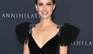 """FILE - In this Feb. 13, 2018, file photo, Natalie Portman arrives at the Los Angeles premiere of """"Annihilation"""" at the Regency Village Theatre. The foundation behind the prestigious Genesis Prize says this year's winner, Natalie Portman, has pulled out of the June awards ceremony in Israel, quoting a representative for the U.S. actress as saying recent events in Israel were """"extremely distressing to her,"""" according to a statement on Thursday, April 19, 2018. (Photo by Jordan Strauss/Invision/AP, File)"""