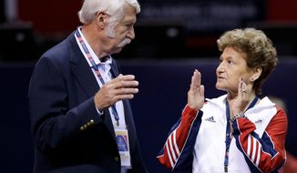 """FILE - In this June 29, 2012, file photo, Bela, left, and Martha Karolyi talk on the arena floor before the start of the preliminary round of the women's Olympic gymnastics trials in San Jose, Calif.  Former USA Gymnastics women's national team coordinator Martha Karolyi and her husband Bela tell NBC they were unaware of the abusive behavior by a former national team doctor now serving decades in prison. Martha Karolyi led the national team for 15 years before retiring after the 2016 Rio Olympics. She tells Savannah Guthrie in """"no way"""" did she suspect Larry Nassar was sexually abusing athletes. (AP Photo/Gregory Bull, File)"""