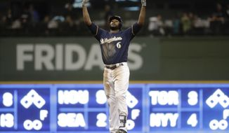 Milwaukee Brewers' Lorenzo Cain reacts after hitting an RBI double during the sixth inning of a baseball game against the Miami Marlins Thursday, April 19, 2018, in Milwaukee. (AP Photo/Morry Gash)