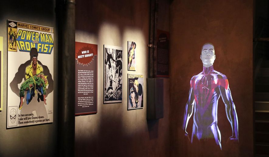 In this photo taken Wednesday, April 18, 2018, comic memorabilia are displayed during a preview of the exhibit Marvel: Universe of Super Heroes at the Museum of Pop Culture (MoPOP), in Seattle. The exhibit, which opens Saturday, April 21, features more than 300 original Marvel artifacts, including comic pages, costumes and props and chronicles nearly eight decades of Marvel's story. (AP Photo/Elaine Thompson)
