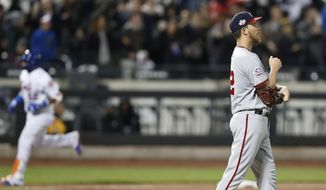 Washington Nationals starting pitcher A.J. Cole, right, looks to the outfield as New York Mets' Yoenis Cespedes, left, runs the bases after hitting a grand slam in the eighth inning of a baseball game, Wednesday, April 18, 2018, in New York. (AP Photo/Kathy Willens) **FILE**