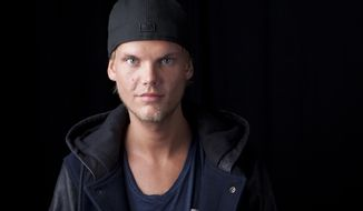 In this Aug. 30, 2013, file photo, Swedish DJ-producer Avicii poses for a portrait in New York. Swedish-born Avicii, whose name is Tim Bergling, was found dead, Friday April 20, 2018, in Muscat, Oman. He was 28. (Photo by Amy Sussman/Invision/AP, File)