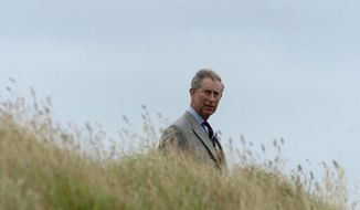 FILE - In this Sunday, March 6, 2005 file photo, Britain's Prince Charles tours the Taiaroa Heads Nature Reserve, near Dunedin, New Zealand. Prince Charles is in New Zealand for a five day visit and spent the afternoon viewing a colony of Northern Royal Albatross' at Taiaroa Heads. (AP Photo/Fotopress, Phil Walter)
