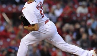 St. Louis Cardinals' starting pitcher Michael Wacha throws against the Cincinnati Reds in the first inning of a baseball game, Friday, April 20, 2018, at Busch Stadium in St. Louis. (AP Photo/Bill Boyce)