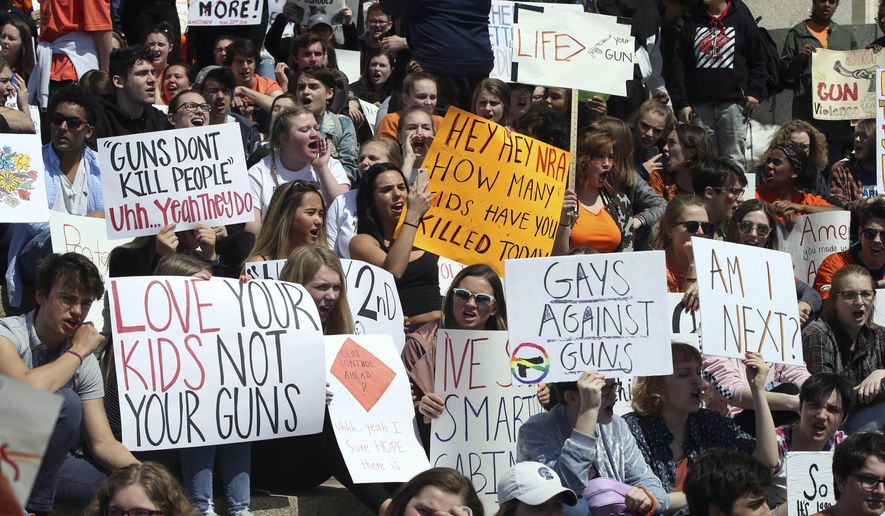 Hundreds of students gathered Friday, April 20, 2018, at the State Capitol in St. Paul, Minn., to protest gun violence, part of a national high school walkout on the 19th anniversary of the Columbine shootings. (AP Photo/Jim Mone)