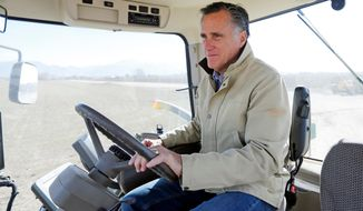 FILE - In this Feb. 16, 2018, file photo, shows former Republican presidential candidate Mitt Romney sitting behind the wheel of a tractor during a tour of Gibson's Green Acres Dairy in Ogden, Utah. Romney is gearing up for arguably the biggest challenge of his Senate campaign: A Utah Republican party convention where he'll have to face down nearly a dozen contenders in front of a far-right-leaning audience. (AP Photo/Rick Bowmer, File)'