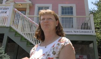 In this June 21, 2008, file photo, Susette Kelo, left, former owner of the controversial little pink house, stands in front of her old home at its new location in New London, Conn. Susette Kelo took on the city of New London, which was trying to take her house through eminent domain. She ultimately lost in a 5-4 decision by the Supreme Court. (AP Photo/Jessica Hill, File)  **FILE**