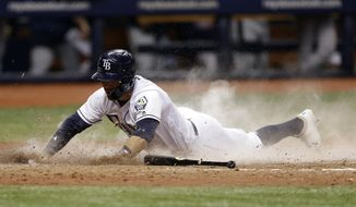 Tampa Bay Rays' Johnny Field scores the winning run when Minnesota Twins relief pitcher Zach Duke dropped the ball on a play at first base with Rays' Denard Span during the 10th inning of a baseball game Friday, April 20, 2018, in St. Petersburg, Fla. The Rays won 8-7. (AP Photo/Chris O'Meara)