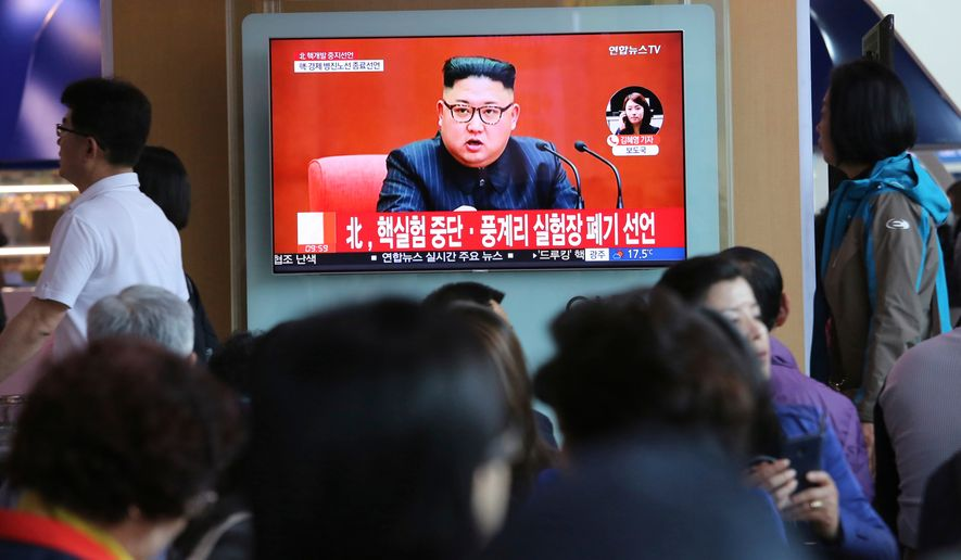 "In this April 21, 2018, file photo, people watch a TV screen showing an image of North Korean leader Kim Jong-un during a news program at the Seoul Railway Station in Seoul, South Korea. The signs read: ""North Korea says it has suspended nuclear tests."" (AP Photo/Ahn Young-joon, File)"