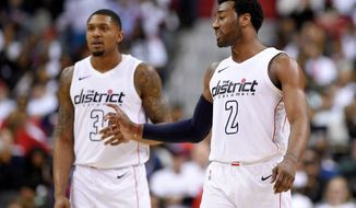 Washington Wizards guard John Wall (2) gestures in front of Bradley Beal (3) during the second half of Game 3 of an NBA basketball first-round playoff series against the Toronto Raptors, Friday, April 20, 2018, in Washington. The Wizards won 122-103. (AP Photo/Nick Wass) ** FILE **