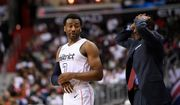 Washington Wizards guard John Wall (2) stands next to Toronto Raptors head coach Dwane Casey, right, during the second half of Game 3 of an NBA basketball first-round playoff series, Friday, April 20, 2018, in Washington. The Wizards won 122-103. (AP Photo/Nick Wass)