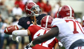 White quarterback Jalen Hurts (2) throws a pass during the second half of an NCAA college football Alabama spring game, Saturday, April 21, 2018, in Tuscaloosa, Ala. (AP Photo/Butch Dill)