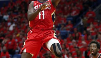 New Orleans Pelicans guard Jrue Holiday (11) goes to the basket during the first half of Game 4 of a first-round NBA basketball playoff series against the Portland Trail Blazers in New Orleans, Saturday, April 21, 2018. (AP Photo/Scott Threlkeld)