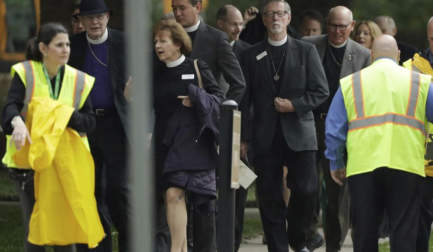 Attendees arrive at St. Martin's Episcopal Church for a funeral service for former first lady Barbara Bush, Saturday, April 21, 2018, in Houston. (AP Photo/Evan Vucci)