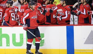 Washington Capitals center Nicklas Backstrom (19), of Sweden, celebrates his goal during the first period in Game 5 of an NHL first-round hockey playoff series against the Columbus Blue Jackets, Saturday, April 21, 2018, in Washington. (AP Photo/Nick Wass)