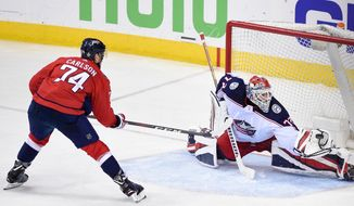 Columbus Blue Jackets goaltender Sergei Bobrovsky (72), of Russia, reaches for the puck in front of Washington Capitals defenseman John Carlson (74) during overtime of Game 5 of an NHL first-round hockey playoff series, Saturday, April 21, 2018, in Washington. The Capitals won 4-3. (AP Photo/Nick Wass) ** FILE **