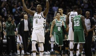Milwaukee Bucks' Eric Bledsoe reacts during the first half of Game 3 of an NBA basketball first-round playoff series against the Boston Celtics Friday, April 20, 2018, in Milwaukee. (AP Photo/Morry Gash)