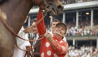 FILE - In this May 2, 1992, file photo, Jockey Pat Day pats Lil E. Tee after they won the 118th running of the Kentucky Derby at Churchill Downs in Louisville, Ky. Pat Day is standing on hallowed ground at Churchill Downs on a recent Monday night, April 23, 2018, but it isn't the Winner's Circle he knows so well nor the finish line he has crossed so many times with no one in front of him. (AP Photo/Ed Reinke, File)