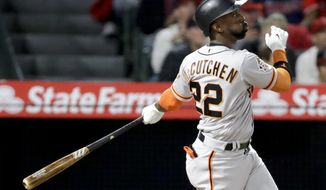 San Francisco Giants' Andrew McCutchen watches his three-run home run against the Los Angeles Angels during the fifth inning of a baseball game in Anaheim, Calif., Friday, April 20, 2018. (AP Photo/Chris Carlson)
