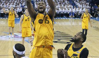 Utah Jazz forward Derrick Favors (15) shoots in front of Oklahoma City Thunder forward Carmelo Anthony (7) and Jazz's Royce O'Neale (23) during the first half of Game 2 of an NBA basketball first-round playoff series in Oklahoma City, Wednesday, April 18, 2018. (AP Photo/Sue Ogrocki)