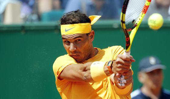 Spain's Rafael Nadal returns the ball to Bulgaria's Gregor Dimitrov during their semifinal singles match of the Monte Carlo Tennis Masters tournament in Monaco, Saturday April 21, 2018. (AP Photo/Christophe Ena)