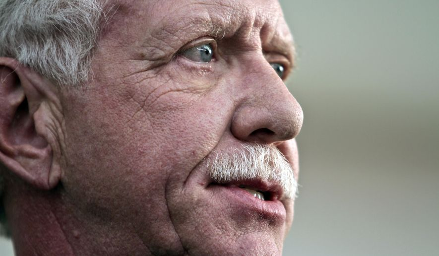 """In this Jan. 15, 2014, file photo, Capt. Chesley """"Sully"""" Sullenberger III, who safely piloted U.S. Airways Flight 1549 with 155 passengers and crew to a water landing, speaks during a press conference in New York. Sullenberger gathered with some survivors rescuers to mark the fifth anniversary of the event known as the """"miracle on the Hudson."""" (Associated Press) ** FILE **"""