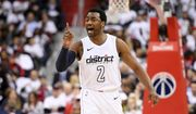 Washington Wizards guard John Wall (2) gestures during the second half of Game 3 of an NBA basketball first-round playoff series against the Toronto Raptors, Friday, April 20, 2018, in Washington. (AP Photo/Nick Wass)